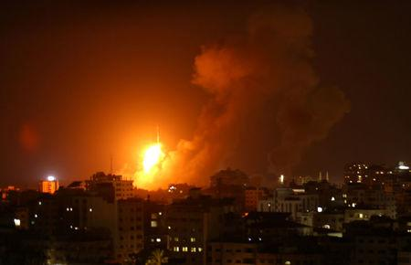 An explosion is seen during an Israeli air strike in Gaza City August 8, 2018. REUTERS/Stringer