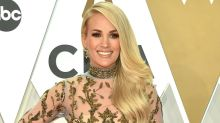 Carrie Underwood attends the 2019 CMA awards in a sheer baroque gown