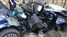 Woman trapped in car next to dead husband all night after crash
