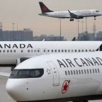 Air Canada pilots reviewing aircraft systems on Boeing's MAX jets