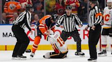 Oilers' Zack Kassian, Flames' Matthew Tkachuk drop the gloves for rematch in first period