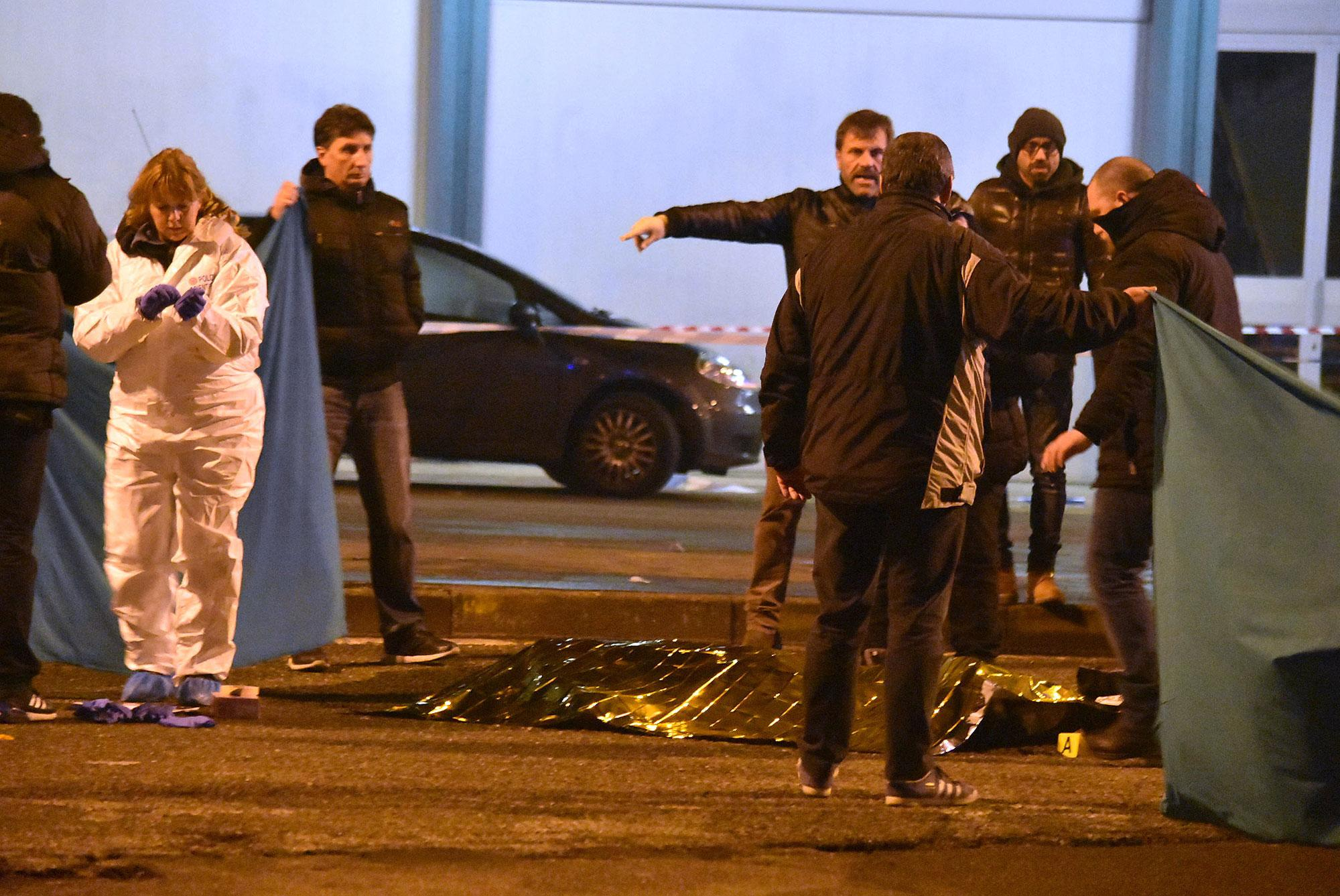 """<p>A body is covered in a thermical blanket as Italian police cordon off an area after a shootout between police and a man in Milan's Sesto San Giovanni neighborhood, early Friday, Dec. 23, 2016. Italy's interior minister Marco Minniti says the man killed in an early-hours shootout in Milan is """"without a shadow of doubt"""" the Berlin Christmas market attacker Anis Amri. (Photo: Daniele Bennati/AP) </p>"""