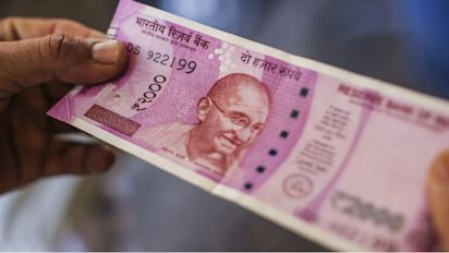 Rupee hits new record low: Trade gap adds to woes