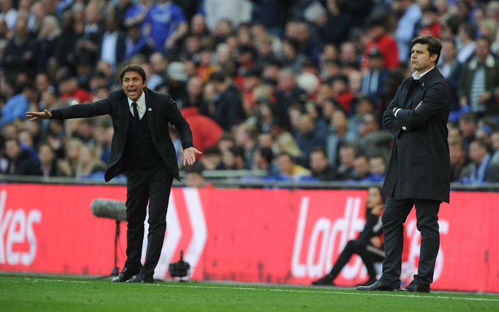 Antonio Conte and Mauricio Pochettino stand in front of an advertisement for Ladbrokes, the FA's betting partner, at the FA Cup semi-final in April - Rex Features