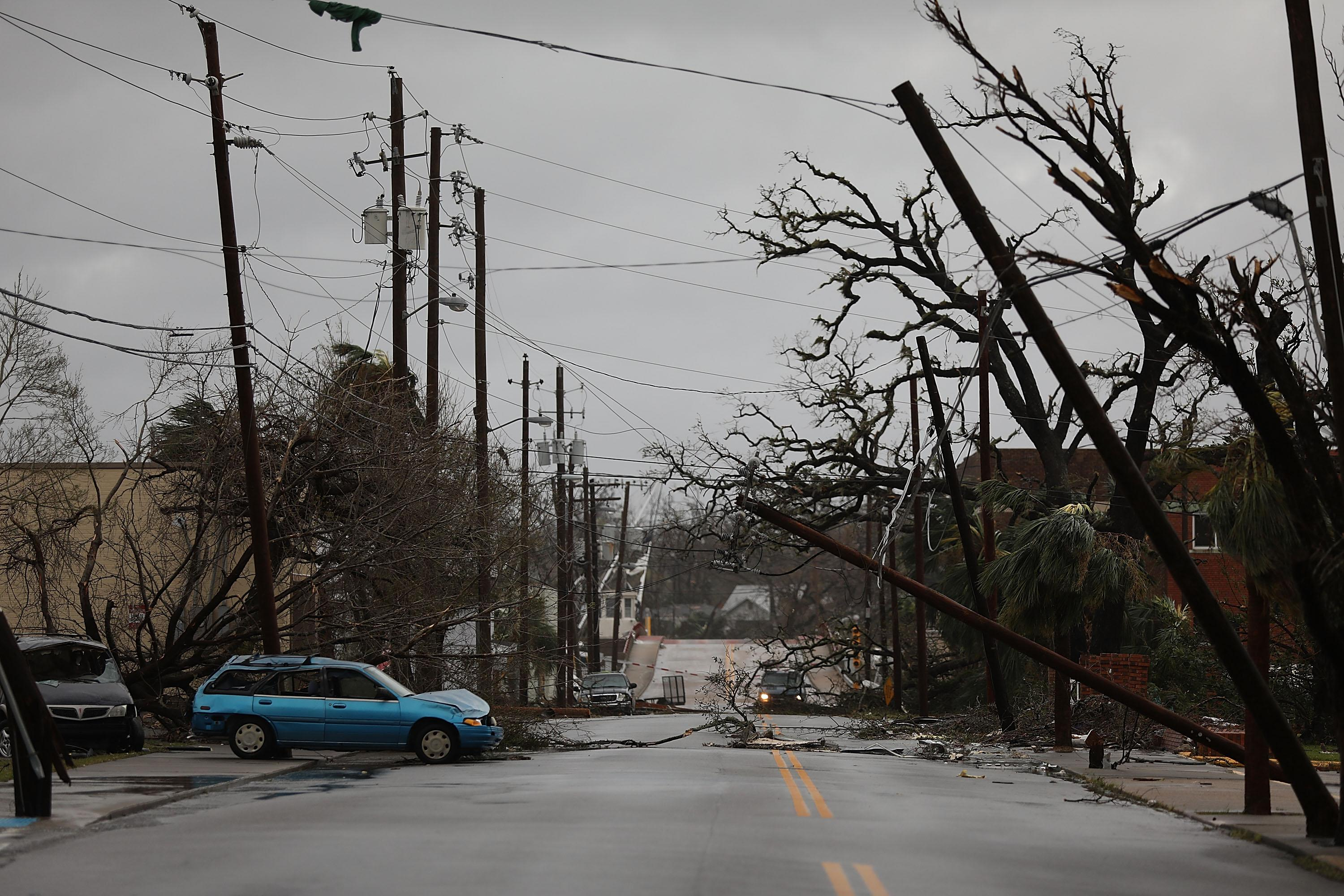 <p>Downed powerlines are seen after hurricane Michael passed through the downtown area on Oct. 10, 2018 in Panama City, Fla. (Photo: Joe Raedle/Getty Images) </p>