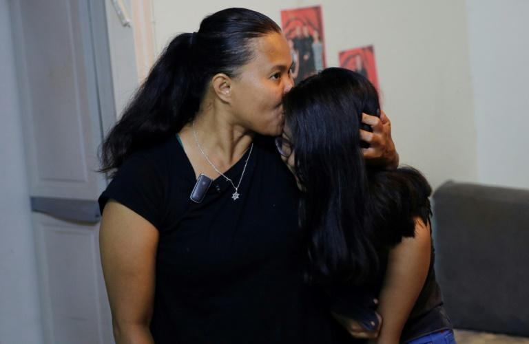 Filipinas Ramela and Sivan Noel, along with some 600 families, now facing expulsion from Israel after losing their residency status (AFP Photo/Gil COHEN-MAGEN)