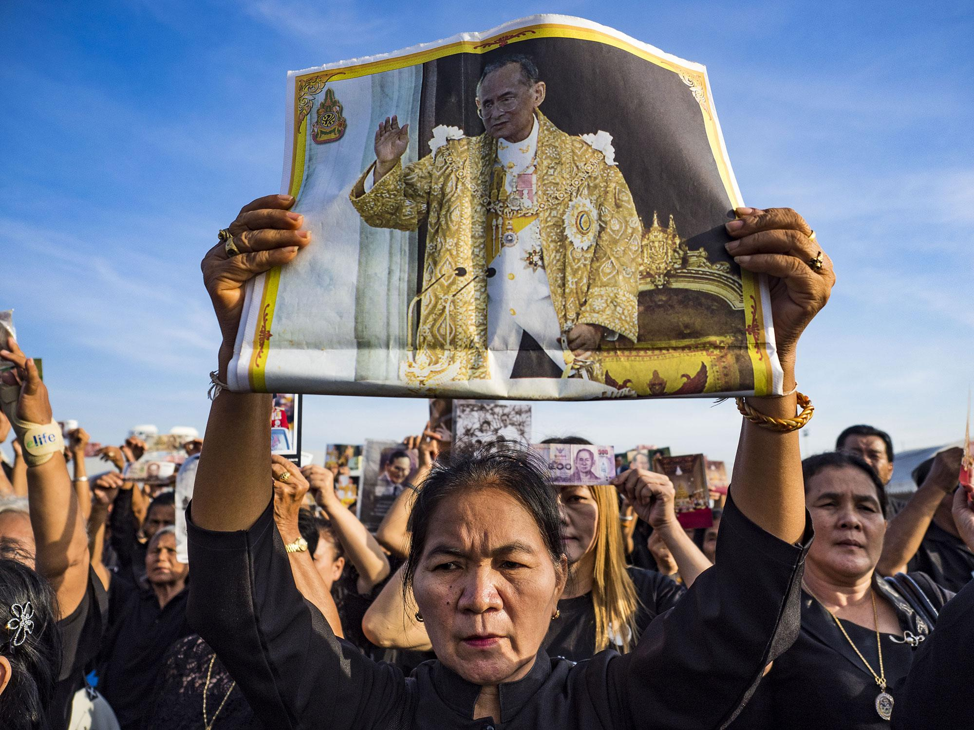 <p>People hold up photos of the late King of Thailand during a ceremony to honor His Majesty at Sanam Luang on November 22, 2016 in Bangkok, Thailand. Hundreds of thousands of Thais gathered across Thailand Tuesday to swear allegiance to Bhumibol Adulyadej, the Late King of Thailand, in a ceremony called Ruam Phalang Haeng Kwam Phakdi (the United Force of Allegiance). At Sanam Luang, the Royal Parade Ground, and location of most of the mourning ceremonies for the late King, people paused to honor His Majesty by singing the Thai national anthem and the royal anthem. (Jack Kurtz via ZUMA Wire) </p>