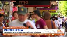 Morrison government considering cutting immigration cap