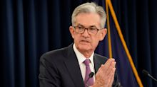 Fed leaves rates unchanged but signals possible rate cuts