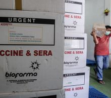 Indonesian health workers receive COVID-19 vaccination