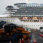 Americans leave quarantined Japan ship as virus cases hit 355