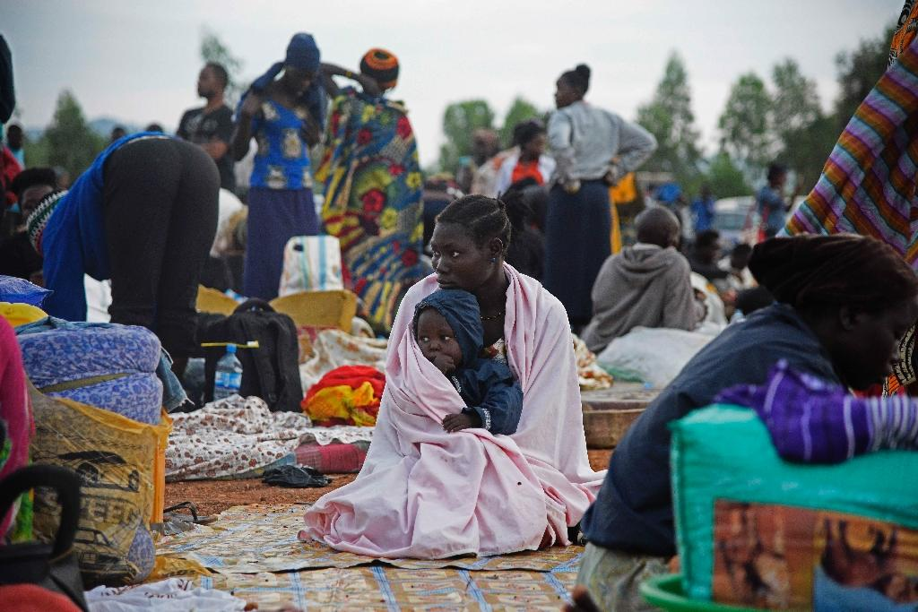 A woman and child pictured at a make-shift camp in the Amuru District of Uganda, which borders war-torn South Sudan, on July 16, 2016 (AFP Photo/Isaac Kasamani)