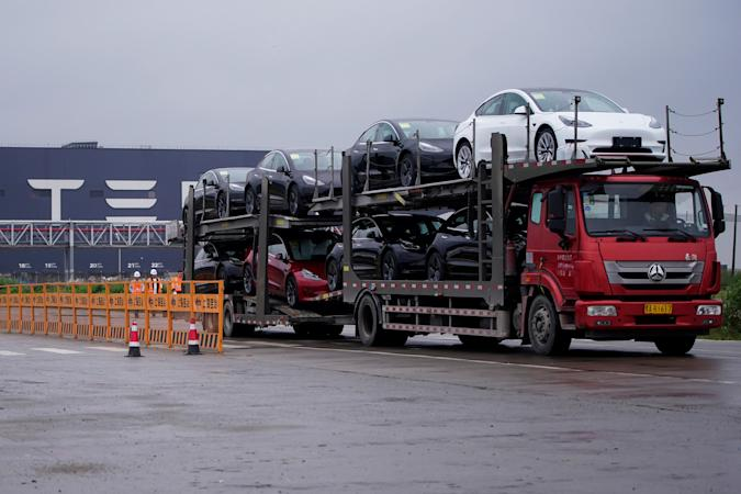A truck transports new Tesla cars at its factory in Shanghai, China May 13, 2021. REUTERS/Aly Song