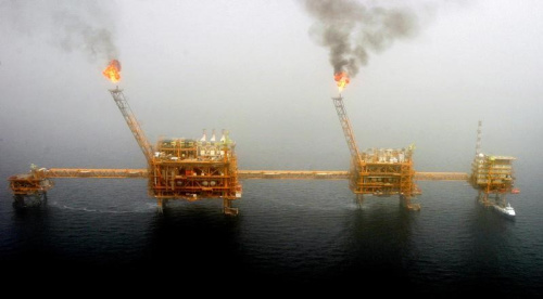 Gas flares from an oil production platform are seen at the Soroush oil fields.