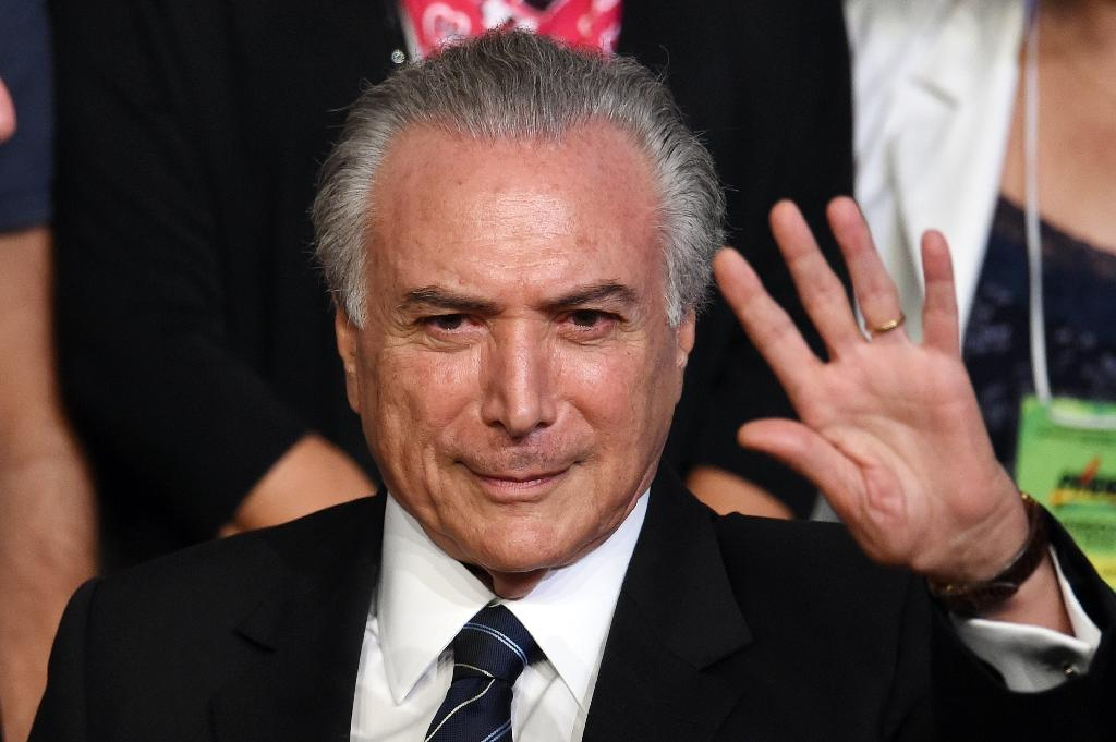 Brazilian Vice President Michel Temer waves during the Brazilian Democratic Movement Party (PMDB) national convention in Brasilia