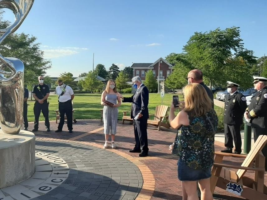 St. Charles North graduate Mary Kate Phillips (center, left) receives the Citizen's Lifesaving Award from St. Charles Mayor Raymond Rogina (center, right) during a small ceremony Aug. 17.