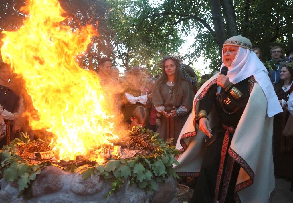 Inija Trinkuniene, high priestess of Lithuania's Romuva neo-pagan community, presides over a fire ritual marking the summer solstice in Vilnius (AFP Photo/Petras Malukas)