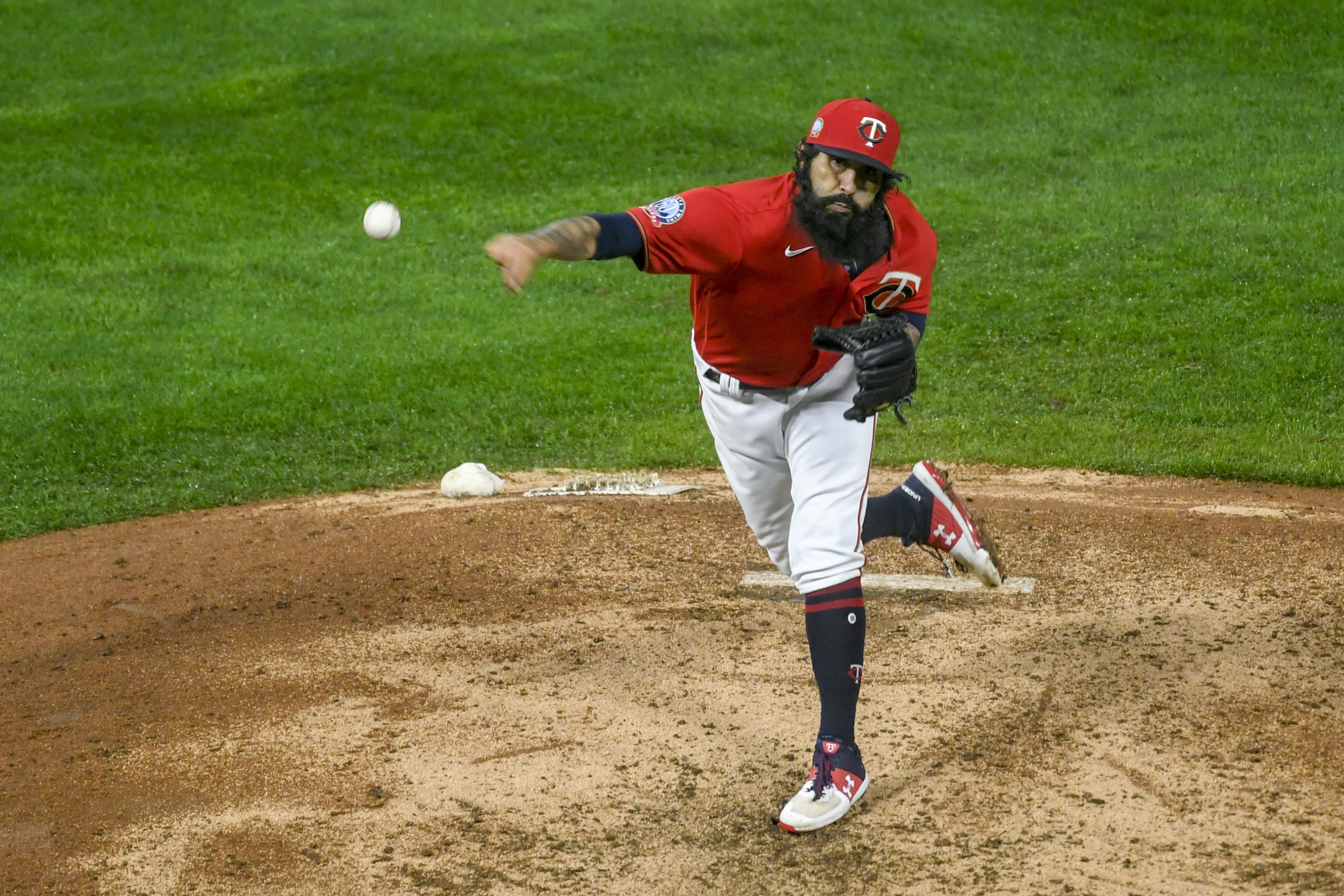 Minnesota Twins pitcher Sergio Romo throws to a Cleveland Indians batter during the eighth inning of a baseball game Friday, Sept. 11, 2020, in Minneapolis. The Twins won 3-1. (AP Photo/Craig Lassig)