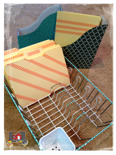 """<p>Dress up a cheap-o plastic plate drying rack with pretty washi tape, then take advantage of those dividers to organize important files. (Credit: <a href=""""http://www.theorganizedclassroomblog.com/"""" rel=""""nofollow noopener"""" target=""""_blank"""" data-ylk=""""slk:The Organized Classroom"""" class=""""link rapid-noclick-resp"""">The Organized Classroom</a>)<br></p>"""