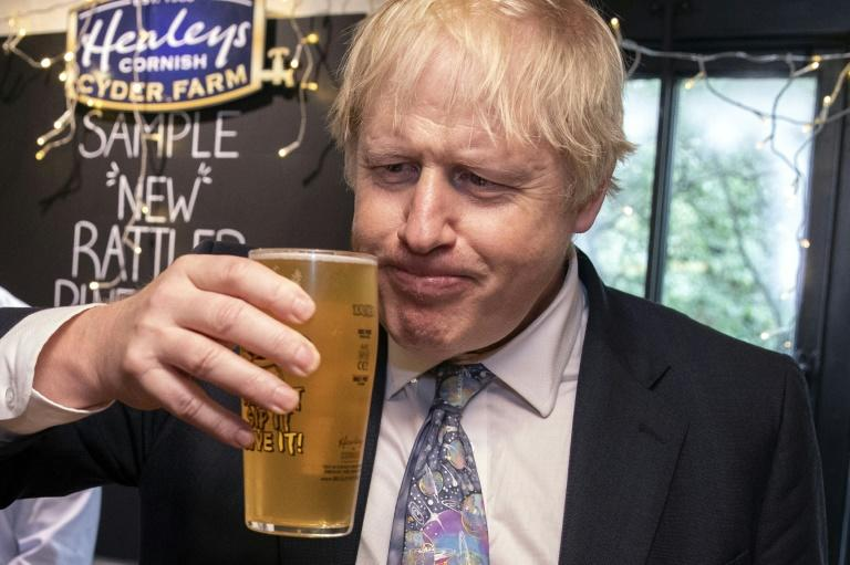 Britain's Prime Minister Boris Johnson has urged the public not to 'blow' Saturday's pub reopenings but police and hospital staff are concerned about public disorder and injuries (AFP Photo/Dan Kitwood)