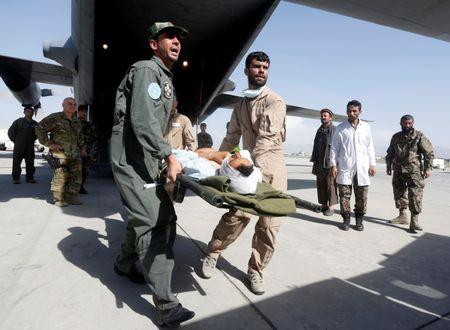 Afghan Air Force medical personnel carry an injured member of the Afghan security forces off a C-130 military transport plane in Kabul, Afghanistan July 9, 2017. REUTERS/Omar Sobhani