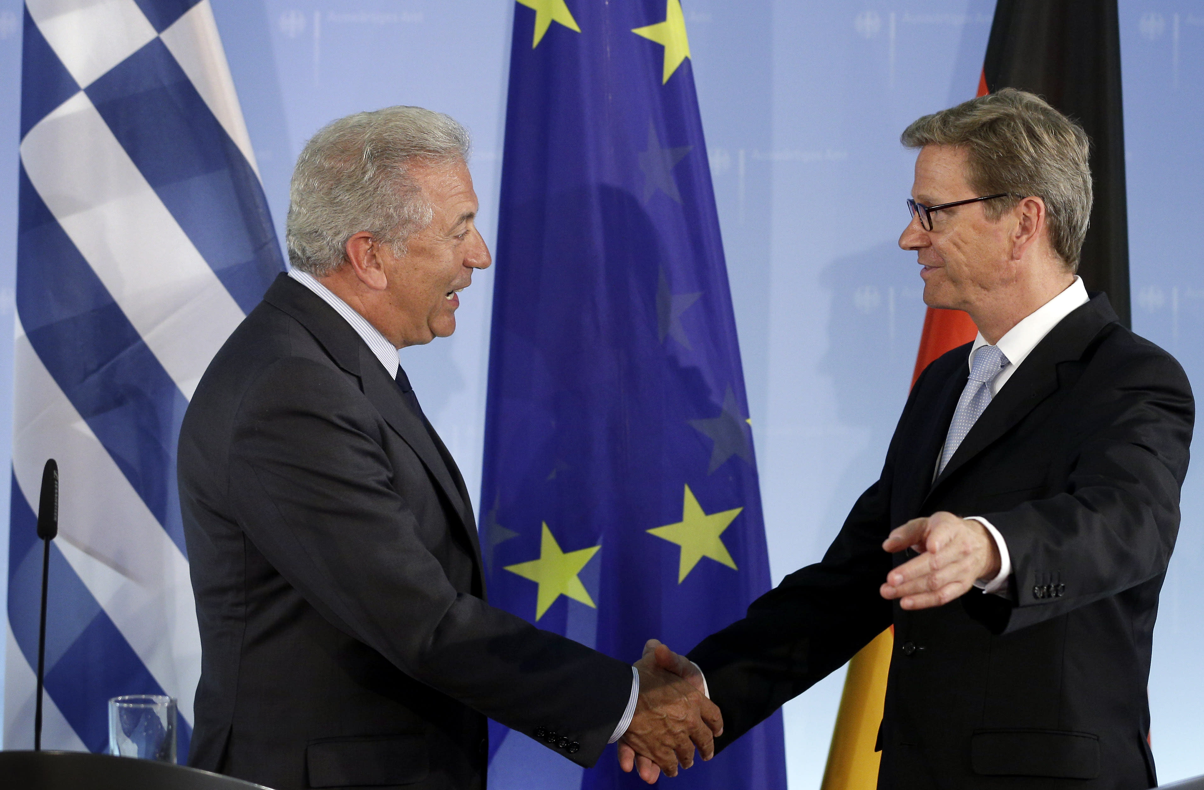 German Foreign Minister Guido Westerwelle right, and his counterpart from Greece, Dimitris Avramopulos, left, shake hands after a joint press conference as part of a meeting at the foreign office in Berlin, Germany, Monday, Aug. 20, 2012. (AP Photo/Michael Sohn)