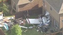 Two hurt as small plane crashes into Texas home