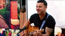 Guy Sebastian gives school kids singing lessons