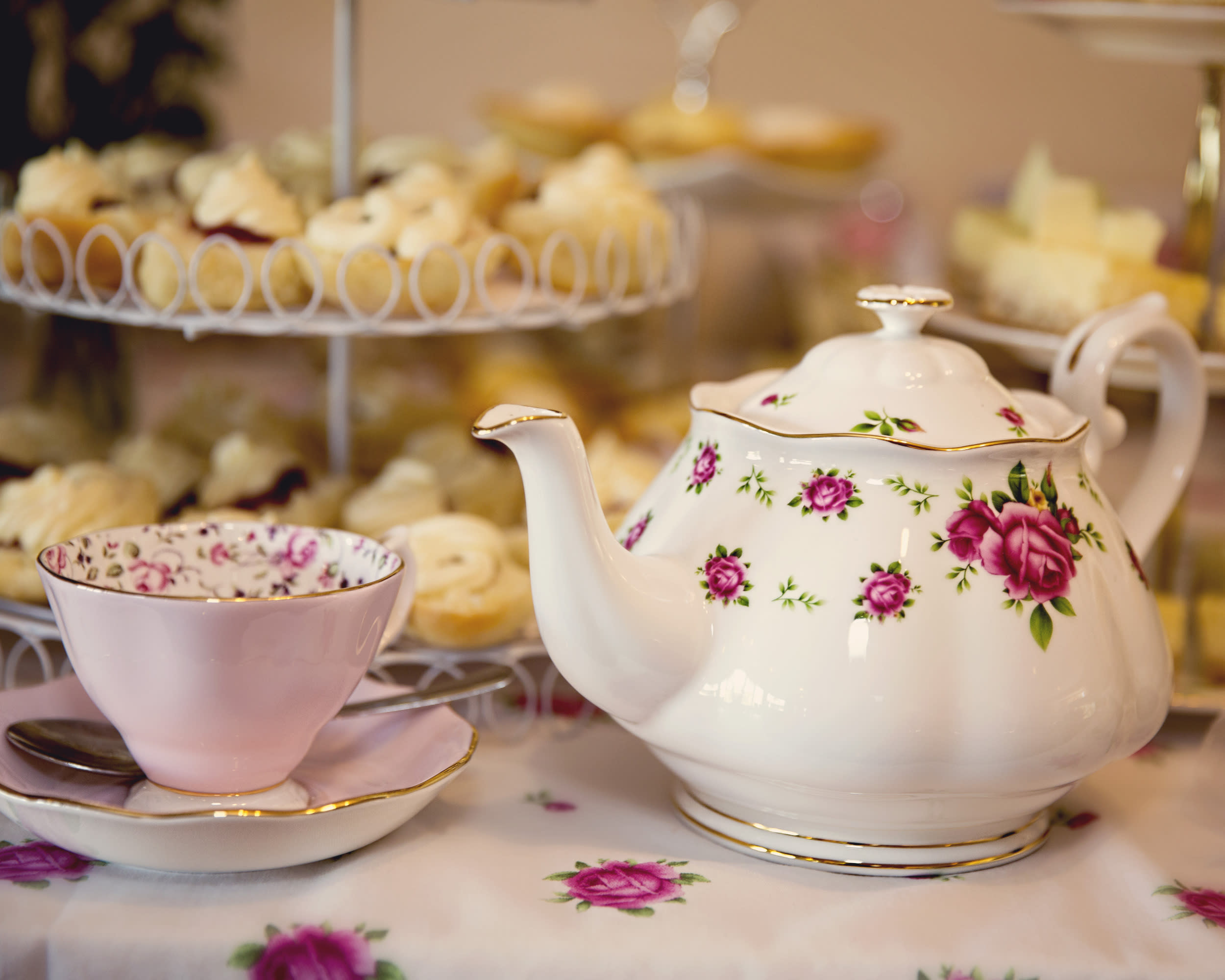 Teapot, cup and saucer and food for a high tea or morning or afternoon tea - elegant