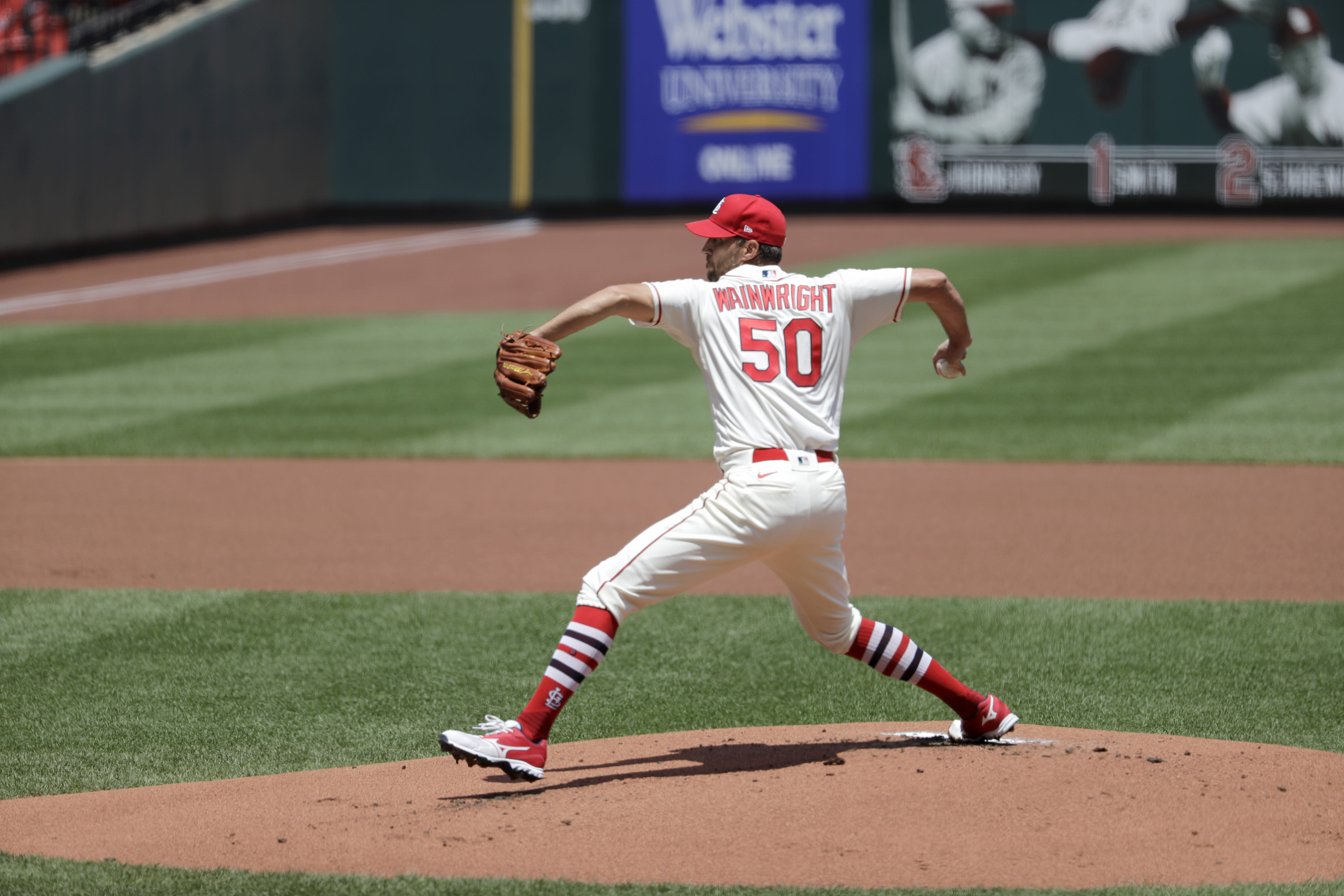 St. Louis Cardinals starting pitcher Adam Wainwright throws during the first inning of a baseball game against the Pittsburgh Pirates Saturday, July 25, 2020, in St. Louis. (AP Photo/Jeff Roberson)
