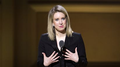 Theranos settles investor suit as funds run low