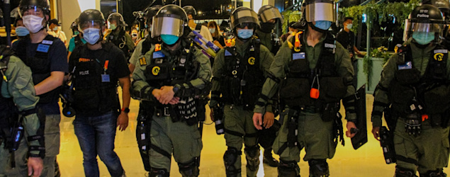 NurPhoto via Getty Images - 駐守機動部隊23歲男警初步確診 潛伏期內無接觸公眾