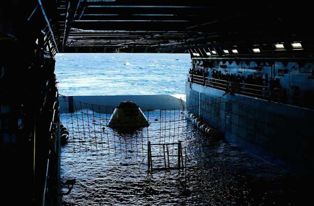 The Big Picture: NASA's Orion capsule floats inside US Navy ship