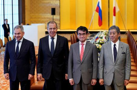 Russian Foreign Minister Sergei Lavrov and Defence Minister Sergei Shoigu pose for a photograph with Japanese Foreign Minister Taro Kono and Defense Minister Takeshi Iwaya before their two-plus-two Foreign and Defense Ministers meeting between Japan and Russia at the Iikura Guest House in Tokyo, Japan, May 30, 2019. Franck Robichon/Pool via Reuters