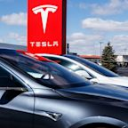 Tesla reports first $1B quarterly profit, GE, UPS earnings beat