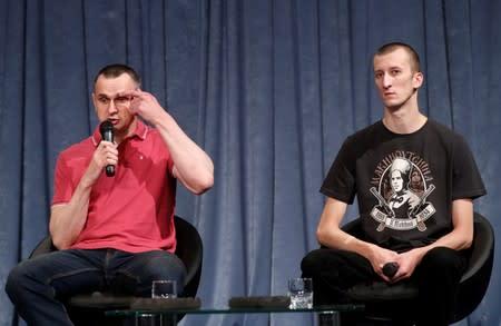 Ukrainian filmmaker Oleg Sentsov and activist Oleksandr Kolchenko attend a news conference in Kiev