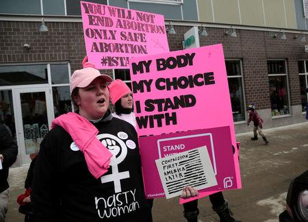 Pro-Choice supporters of Planned Parenthood rally outside a Planned Parenthood clinic in Detroit, Michigan, U.S. February 11, 2017. REUTERS/Rebecca Cook