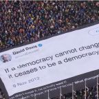 Brexit protesters unfurl giant banner mocking David Davis during Put It To The People March