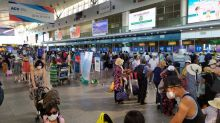 Hundreds jam airport as evacuations from Vietnam's Danang begin