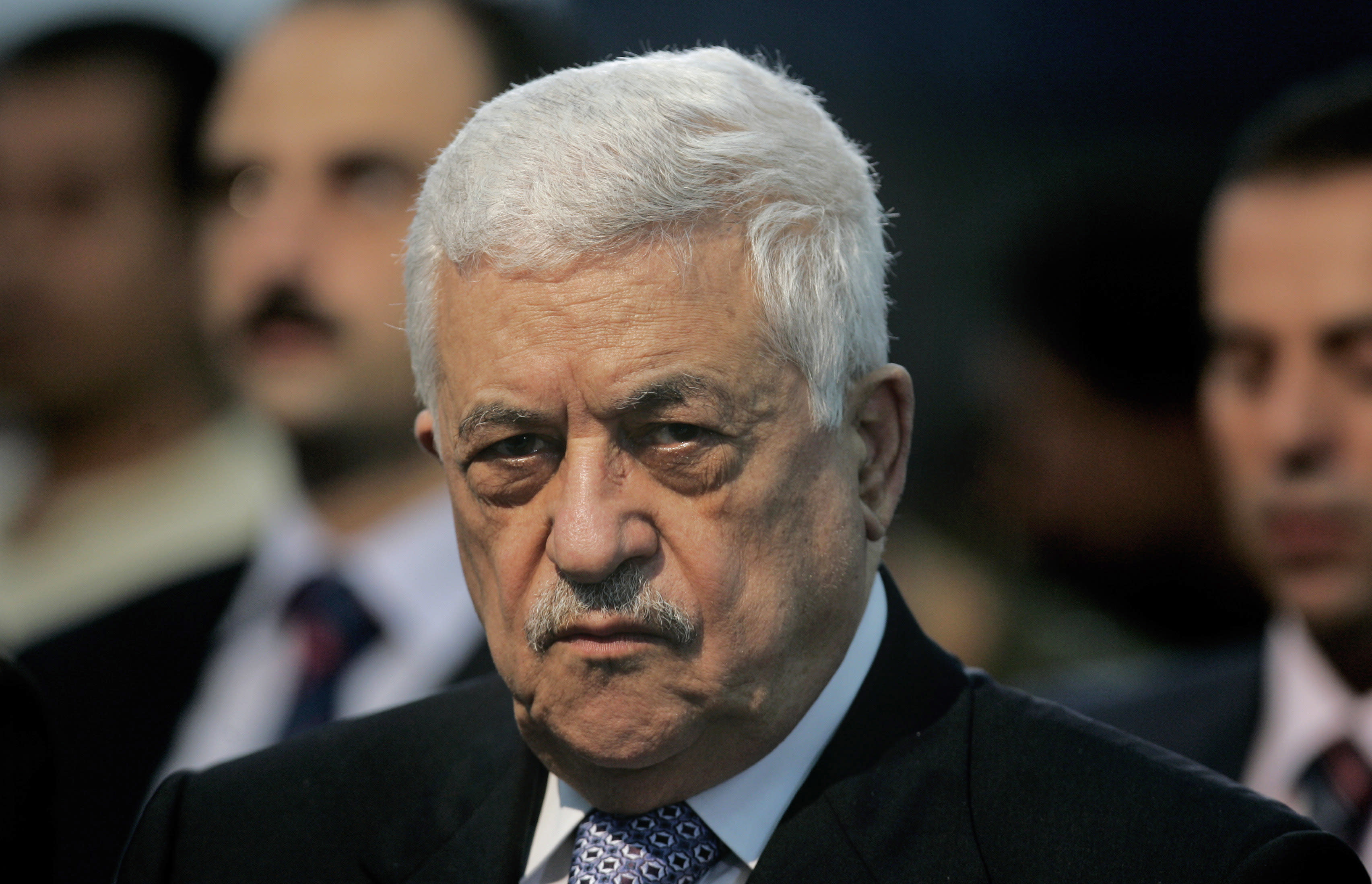"""File -- In this Friday, Oct. 26, 2007 file photo, Palestinian President Mahmoud Abbas, attends Muslim prayers at a mosque adjacent to his office in the West Bank city of Ramallah. Abbas called the Holocaust """"the ugliest crime humanity has known in modern history."""" His comments, published Sunday by the Palestinian official news agency WAFA, marked a rare acknowledgment by an Arab leader of Jewish suffering during the Nazi genocide. Some 6 million Jews perished in the Holocaust. (AP Photo/Muhammed Muheisen, File)"""