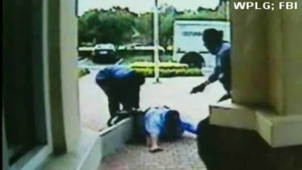 Armored truck robbery, shooting caught on tape