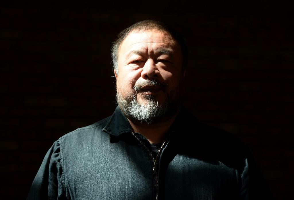 """Chinese dissident and internatioanlly renowned artist Ai Weiwei, pictured in April 2014, says he feels that people pushed away from their home """"are part of me and I am part of them"""""""