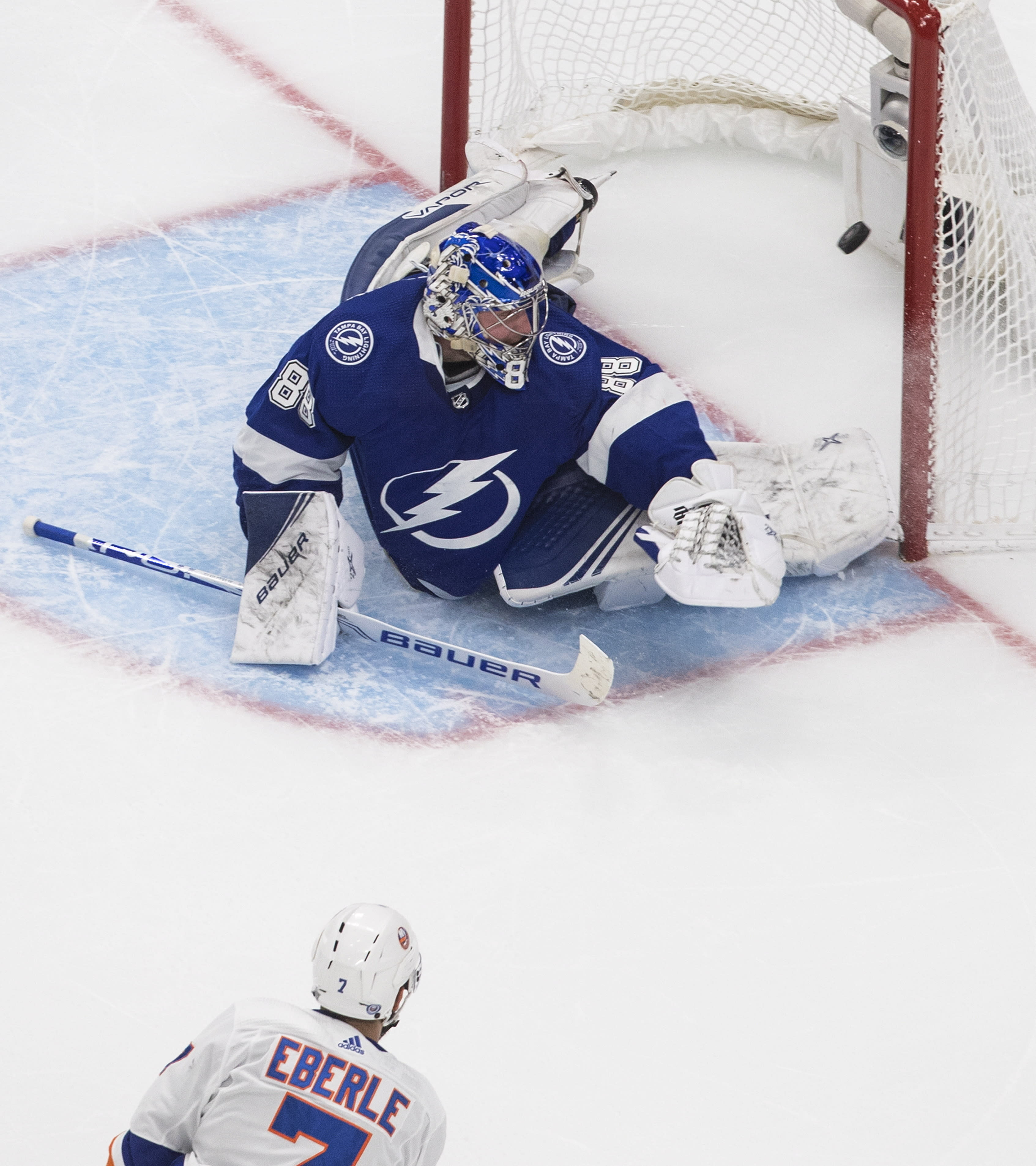 New York Islanders right wing Jordan Eberle (7) scores on Tampa Bay Lightning goaltender Andrei Vasilevskiy (88) during the second overtime in Game 5 of the NHL hockey Eastern Conference final, Tuesday, Sept. 15, 2020, in Edmonton, Alberta. (Jason Franson/The Canadian Press via AP)