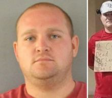 Man Wears Sign Supporting Suspected Cop Killer Outside Florida Sheriff's Office: 'God Bless the Shooter'