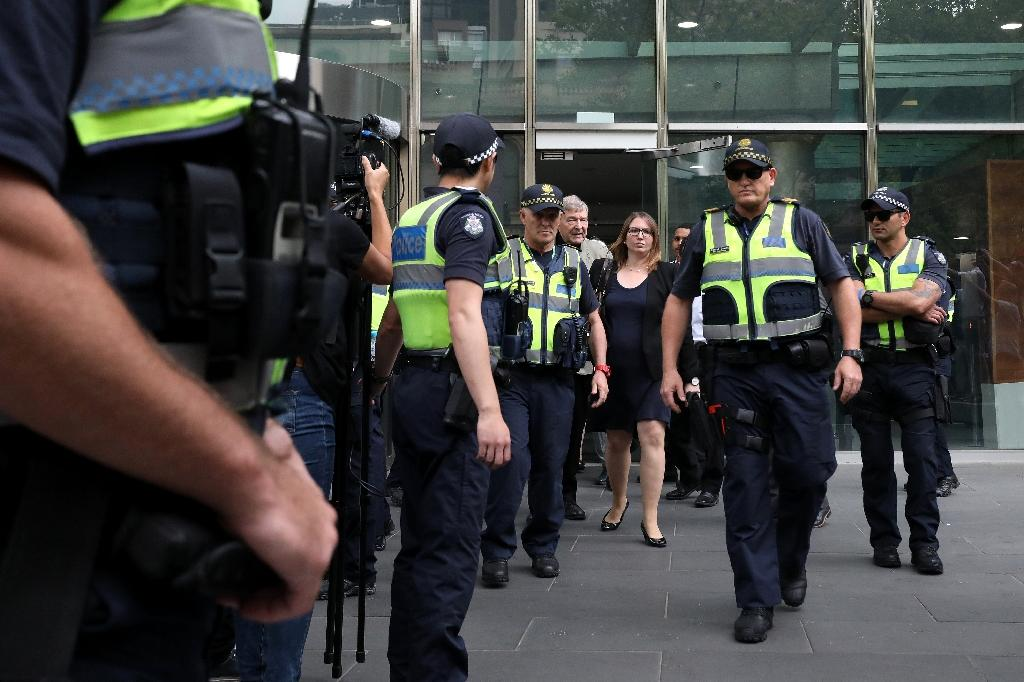 Australian police officers escort Cardinal George Pell from court (AFP Photo/Asanka Brendon Ratnayake)