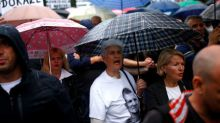 Bosnia families bridge ethnic divide, demand justice for dead sons