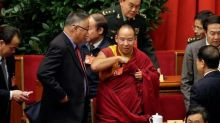 China's Panchen Lama calls for patriotism, says greed taints Tibetan Buddhism
