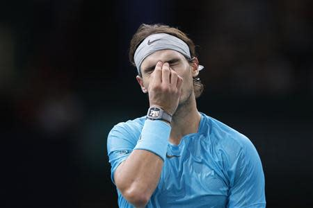 Nadal reacts as he faces Ferrer in their semi-final match of the Paris Masters men's singles tennis tournament