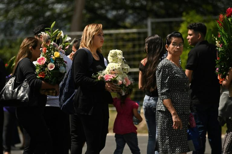 People attending the funeral in San Salvador of Oscar Martinez and his 23-month-old daughter Valeria, who both drowned while trying to cross the Rio Grande from Mexico to the United States