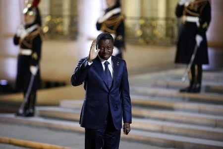 President of Togo Gnassingbe arrives for a dinner with the French President and other dignitaries as part of the Summit for Peace and Security in Africa at the Elysee Palace in Paris